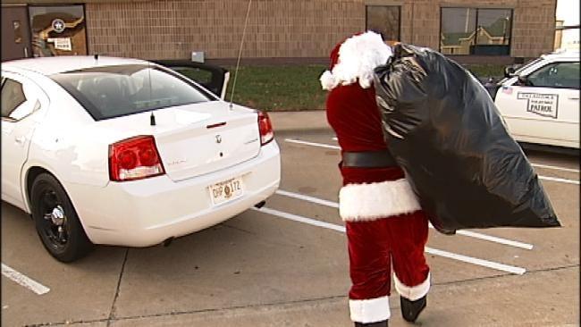 OHP Troopers Help Santa Deliver Teddy Bears
