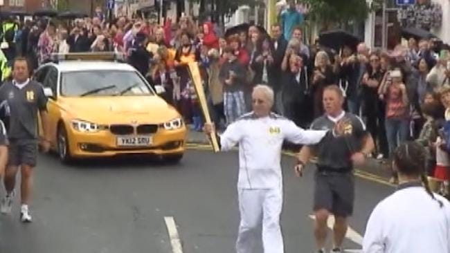 Tulsa Doctor Runs With Olympic Torch In England