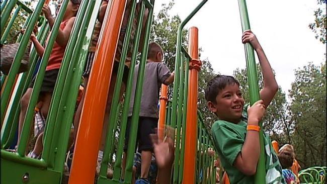 Volunteers Band Together To Refurbish Westside YMCA Playground