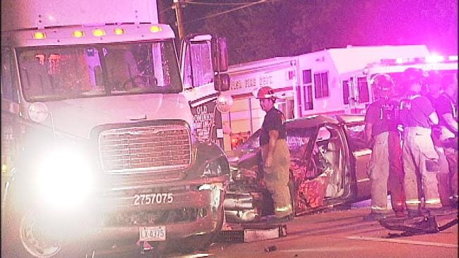 Two Injured When Car Collides With Semi in Tulsa