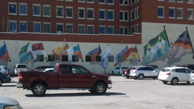 From The KOTV Vault: Artist Paints Flag Mural In Downtown Tulsa In 1984