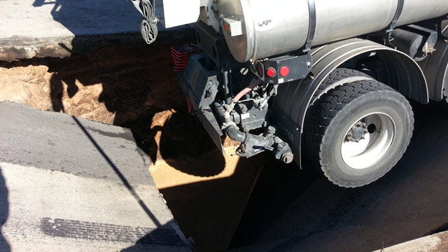 Street Collapses Under City Of Tulsa Utility Truck