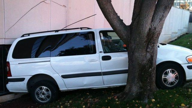 Empty Minivan Rolls Into Tulsa Office Building