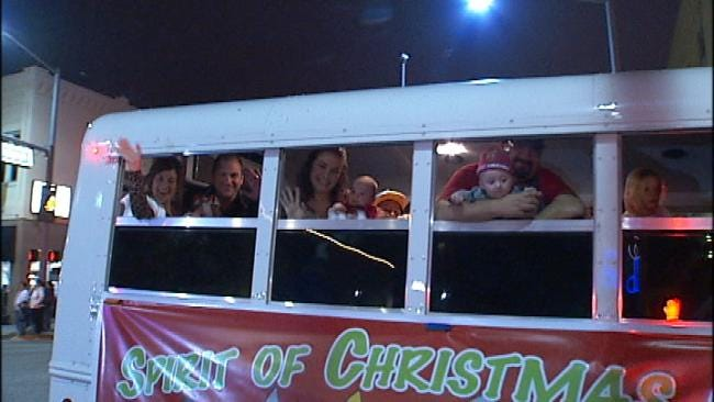 Sand Springs Christmas Parade Rolls On With Busload Of Baby Grand Marshals