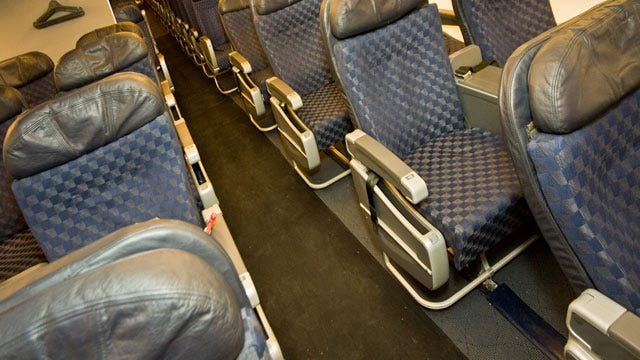American Airlines Mechanics Install Extra Locking Devices On Jetliner Seats