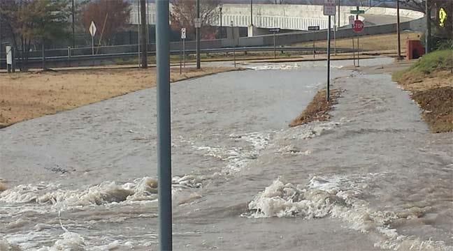 Water Leak Flooding Riverside Drive At 21st Street Bridge