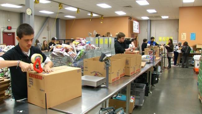 Teens From Brazil Visiting Tulsa Volunteer At Community Food Bank