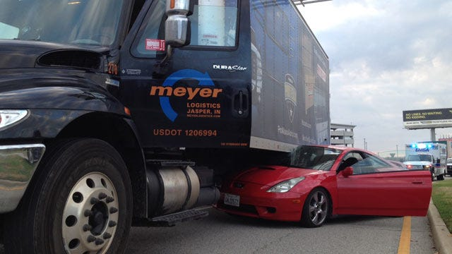 Car Wedged Under Truck In Crash Near Tulsa International Airport