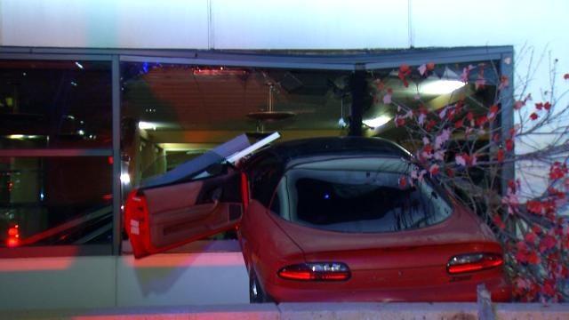 Man Crashes Camaro Through Downtown Tulsa Building