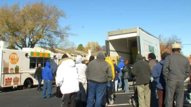 Food Bank Distributes Hundreds Of Holiday Meals To Families In Need