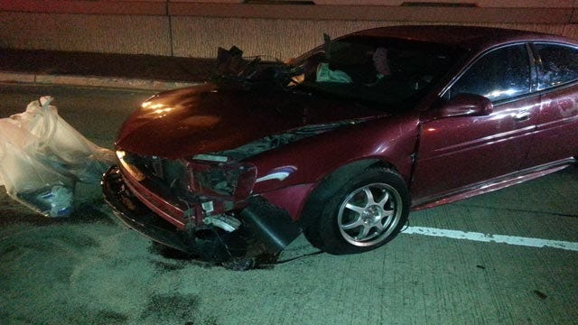 Driver Takes Out Light Pole On I-44, Leaves Wrecked Car Behind