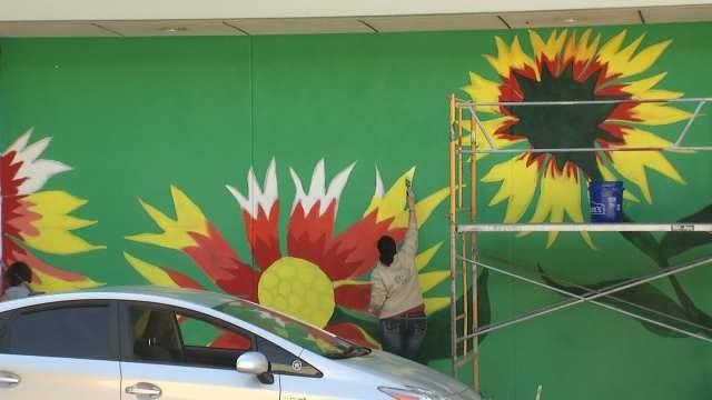 High School Art Students Paint Mural At Tulsa International Airport