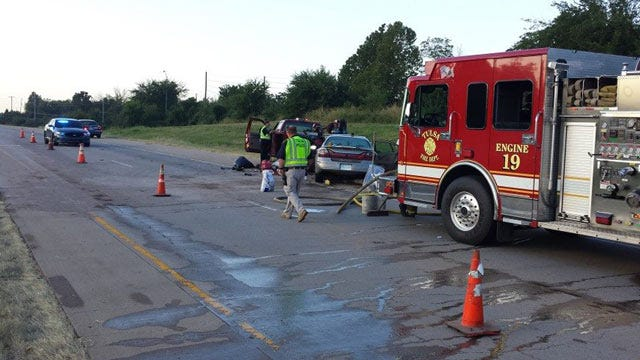 Child Critical After Car Hits Work Truck Parked Along Highway 75 In North Tulsa