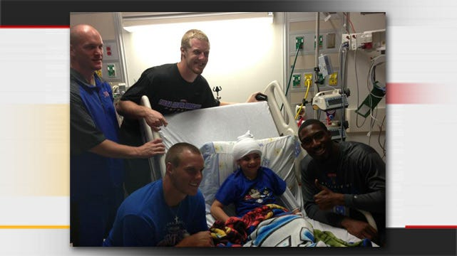 TU Players Visit Collinsville Boy Recovering From Brain Surgery