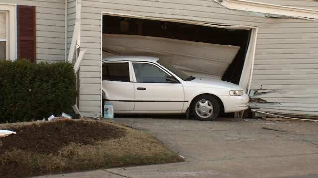 Tulsa Police: Abandoned, Rolled-Over SUV Linked To Car Smashed Into Garage