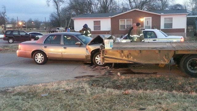 Car Rams Flatbed Trailer Parked On West Tulsa Street