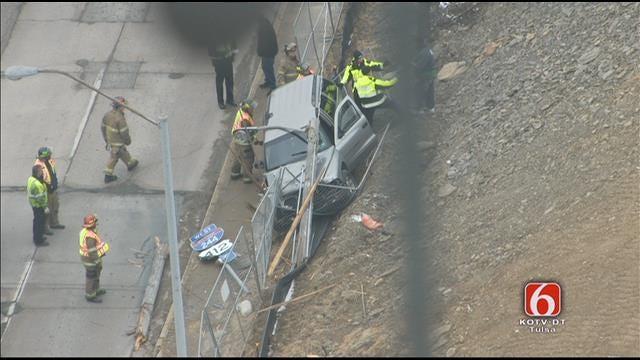 Van Plows Into Light Pole At Tulsa Intersection