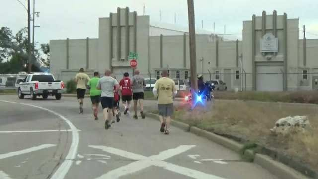 Tulsa Police, Sheriff's Deputies Carry Special Olympics Torch To Stillwater