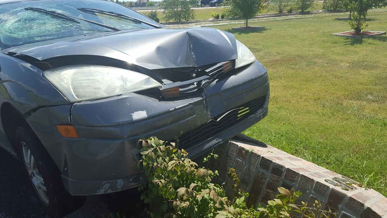 Collinsville Family Surprised By Car Stuck On Mailbox