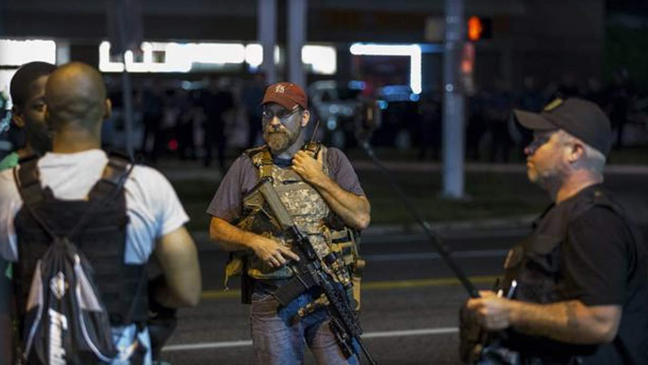'Oath Keepers' Militia Members On Patrol In Ferguson