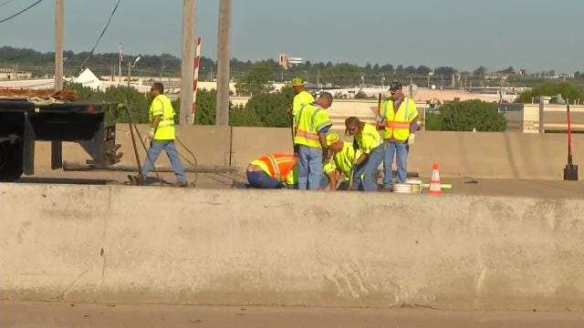 Vehicles Damaged By Highway 169 Expansion Joint