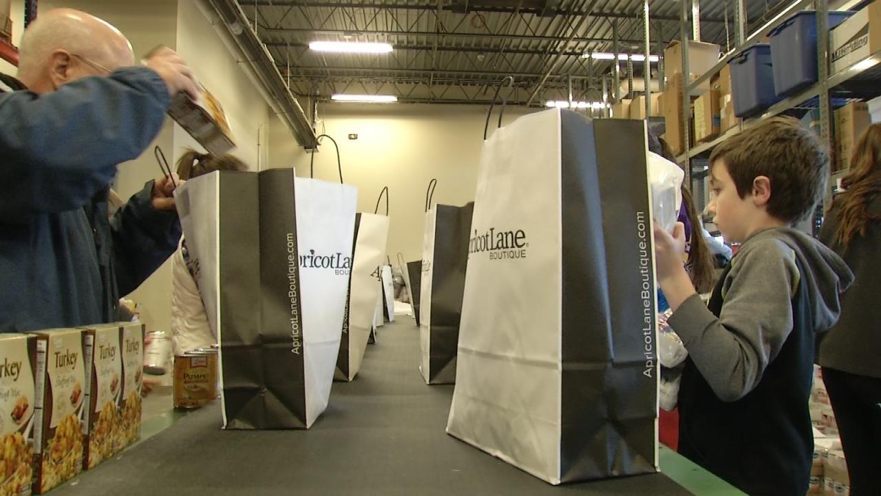 Catholic Charities Of Tulsa Volunteers Share Christmas Spirit With Needy