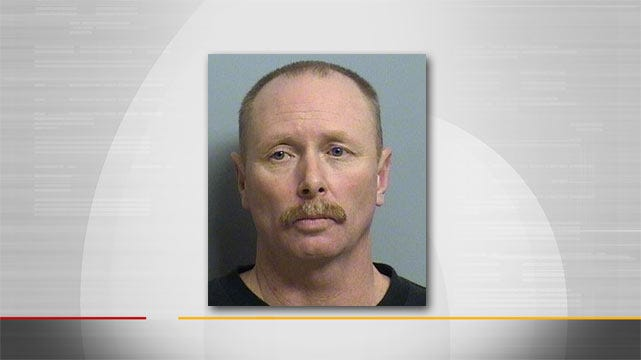 Tulsa Police: Family Finds Half-Naked Man In Motel Bed With Child