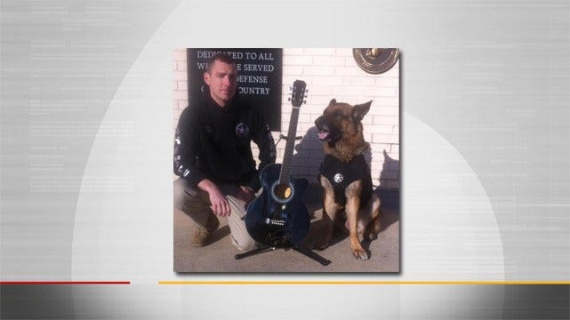 Carrie Underwood Donates Guitar For Auction Benefiting K9 Officer