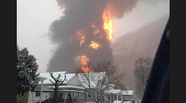 West Virginia Train Derailment Sends Oil Tanker Into River