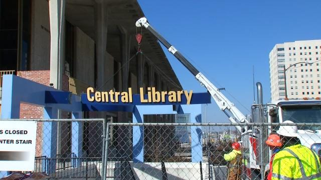 Crews Remove Old Central Library Sign