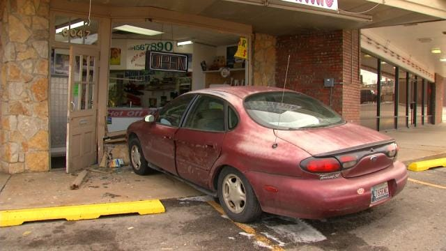 Police: Driver Not Injured When Car Hits Tulsa Business