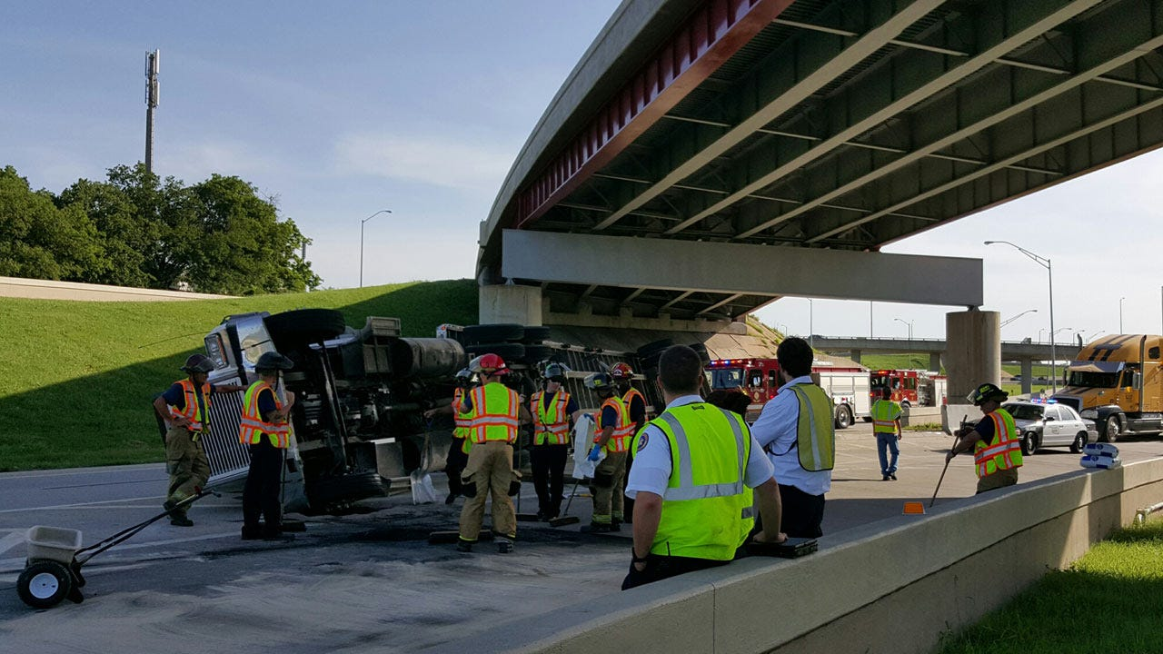 Semi Loaded With Steel Rolls Onto Side On Downtown Tulsa Highway