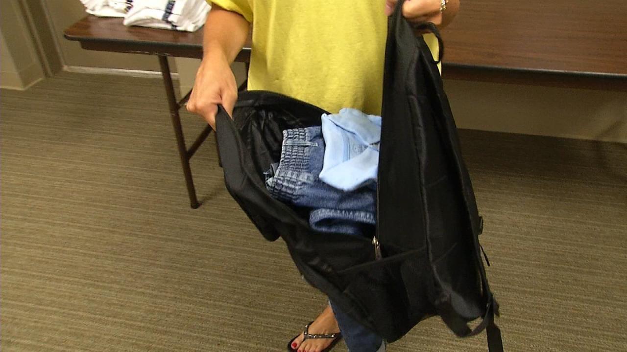 Volunteers Fill Backpacks With School Supplies For Children In Need