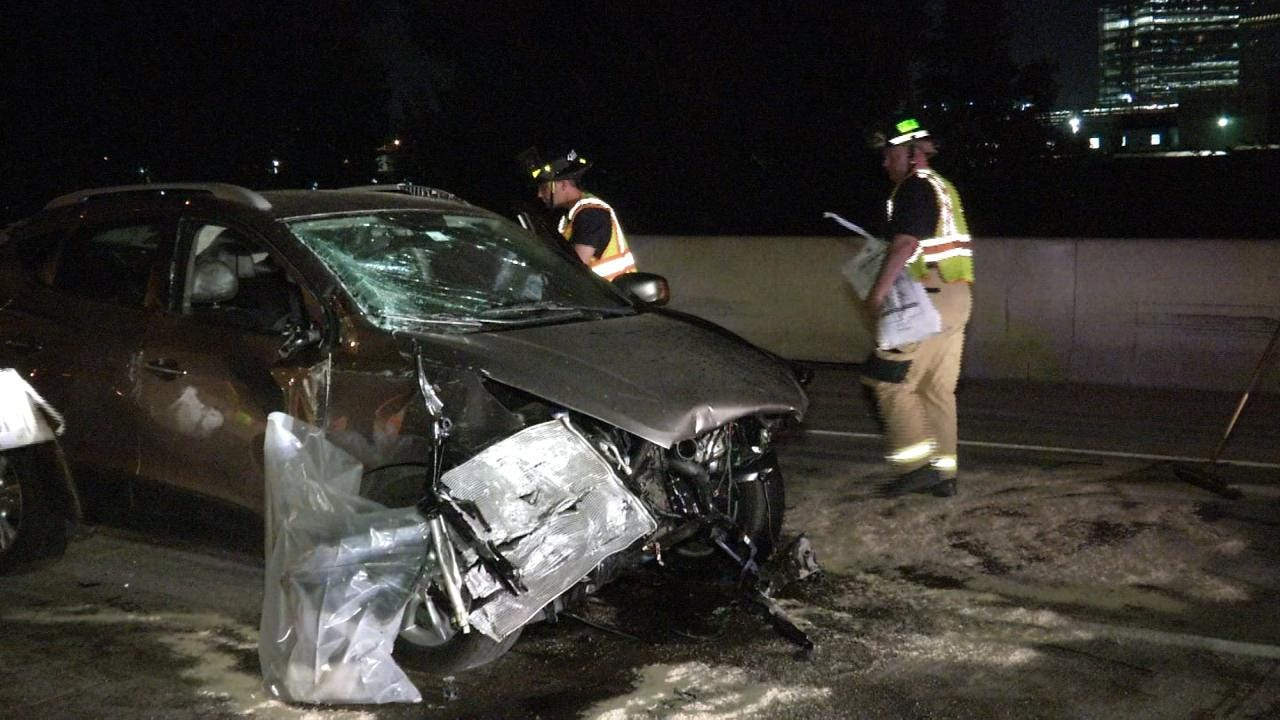 Tulsa Firefighters Clean Up After Car Crashes Into Concrete Barrier