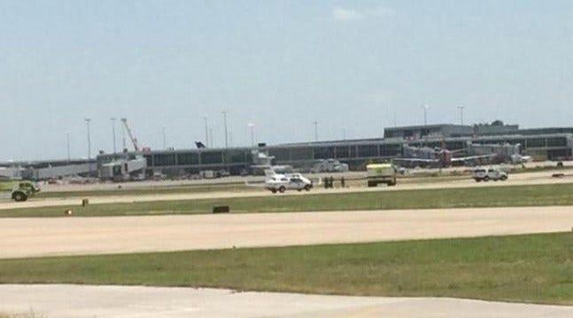 Small Jet Slides Off Runway At Tulsa International Airport