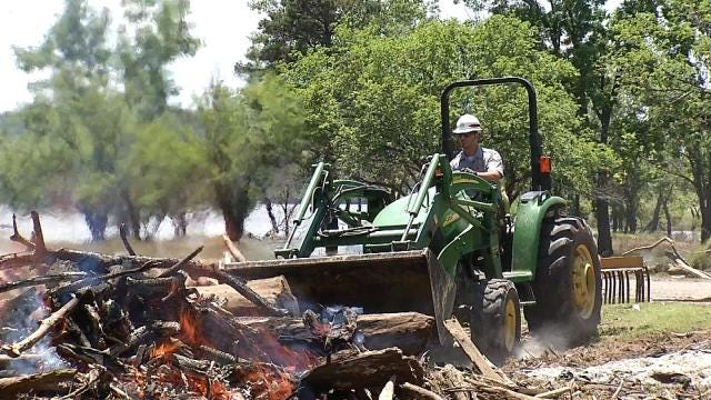 Oklahoma Park Rangers Work To Clear Debris As Water Recedes