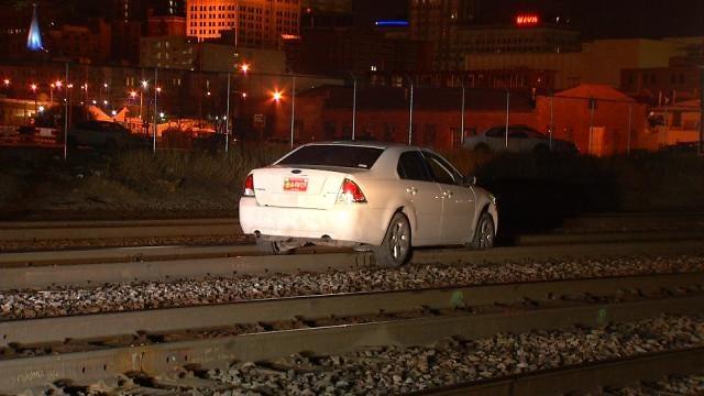 Driver Gets Stuck On Downtown Tulsa Railroad Tracks