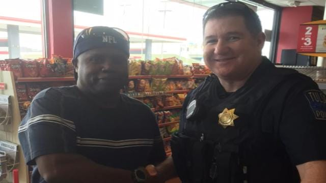 Tulsa Police Officer Hopes To 'Eracism' With His Community Photos
