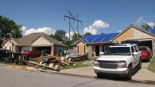 As Rain Moves In, BA Tornado Victims Rush To Repair Roofs