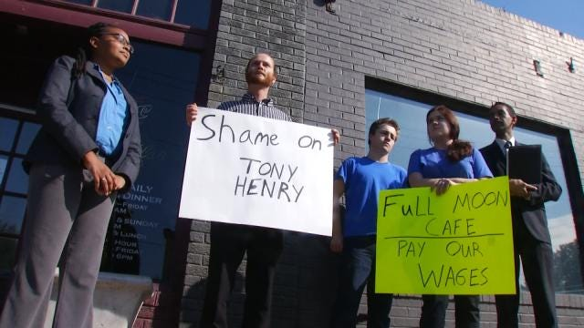 Unpaid Employees Hold Protest Outside Full Moon Cafe Auction
