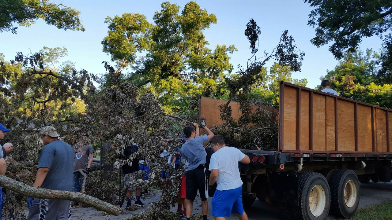 Bixby Football Team Takes Break To Clean Up Storm Debris