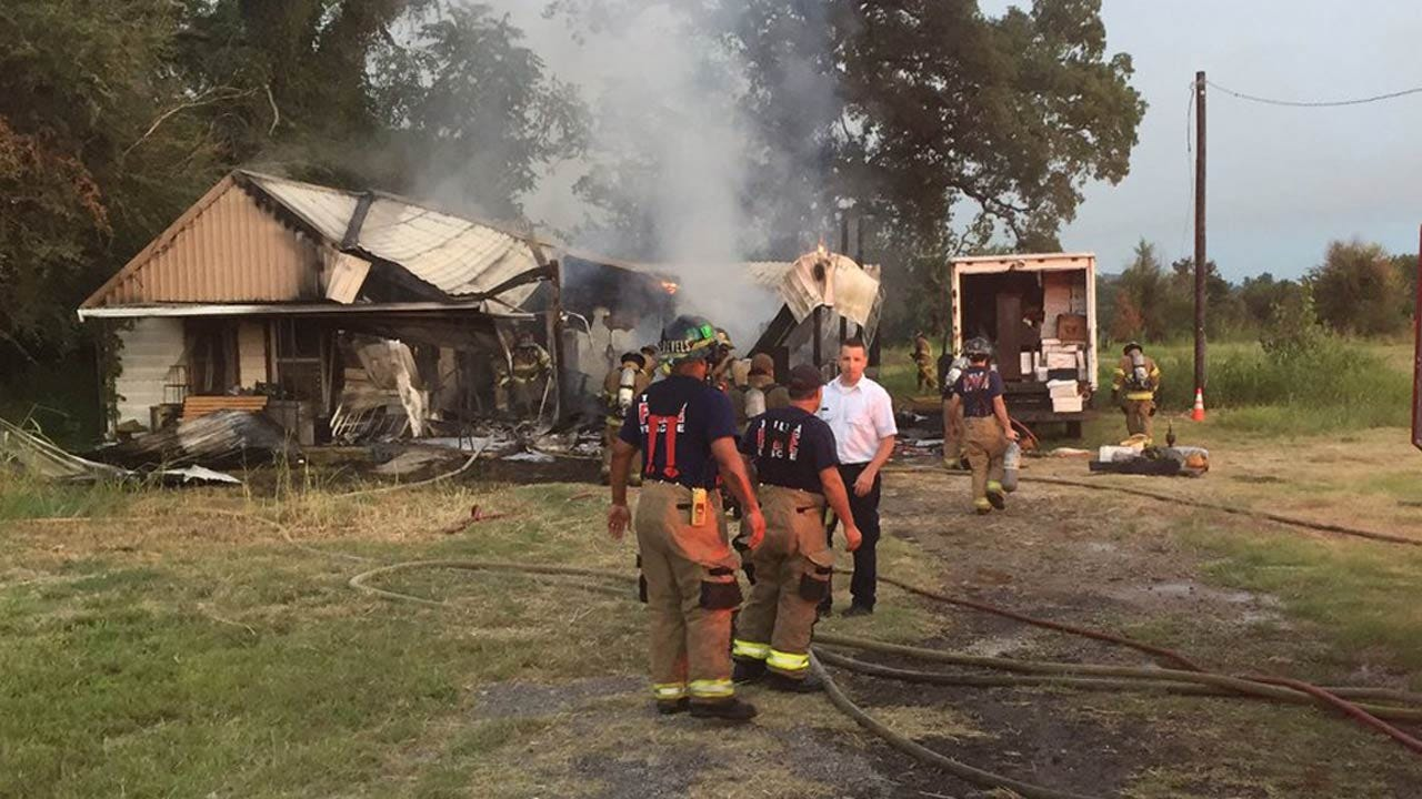 Firefighters Work To Put Out House Fire In West Tulsa