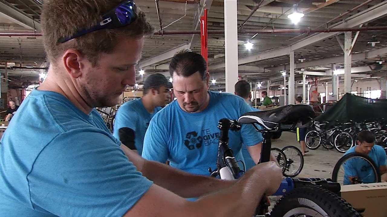 Volunteers Work To Prepare Bikes For Popular TPS Program
