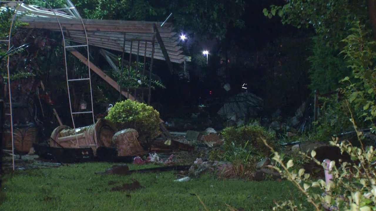 Police: Driver Flees After Pickup Crashes Through Tulsa Home's Yard