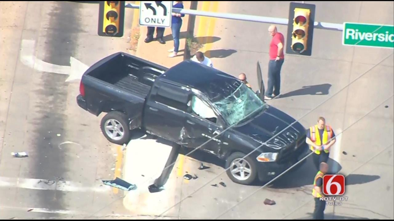 Pickup Rolls Over Hood Of Car In Tulsa Crash