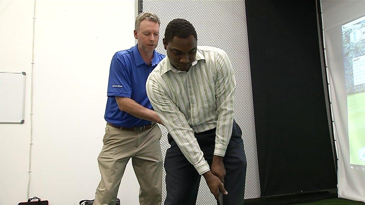 Harold Kuntz Gets Lesson In Irons From Kyley Tetley Of Golf Studio