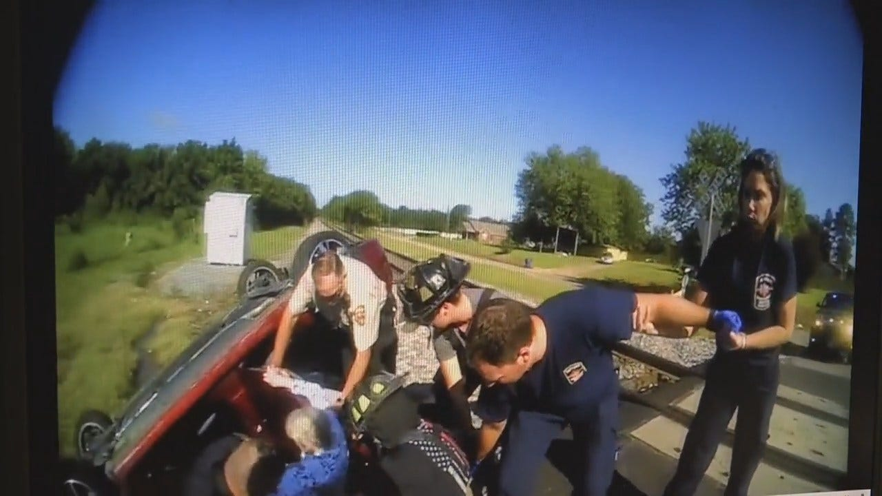 WATCH: Train Barely Misses Muldrow Woman Trapped In Wrecked Car