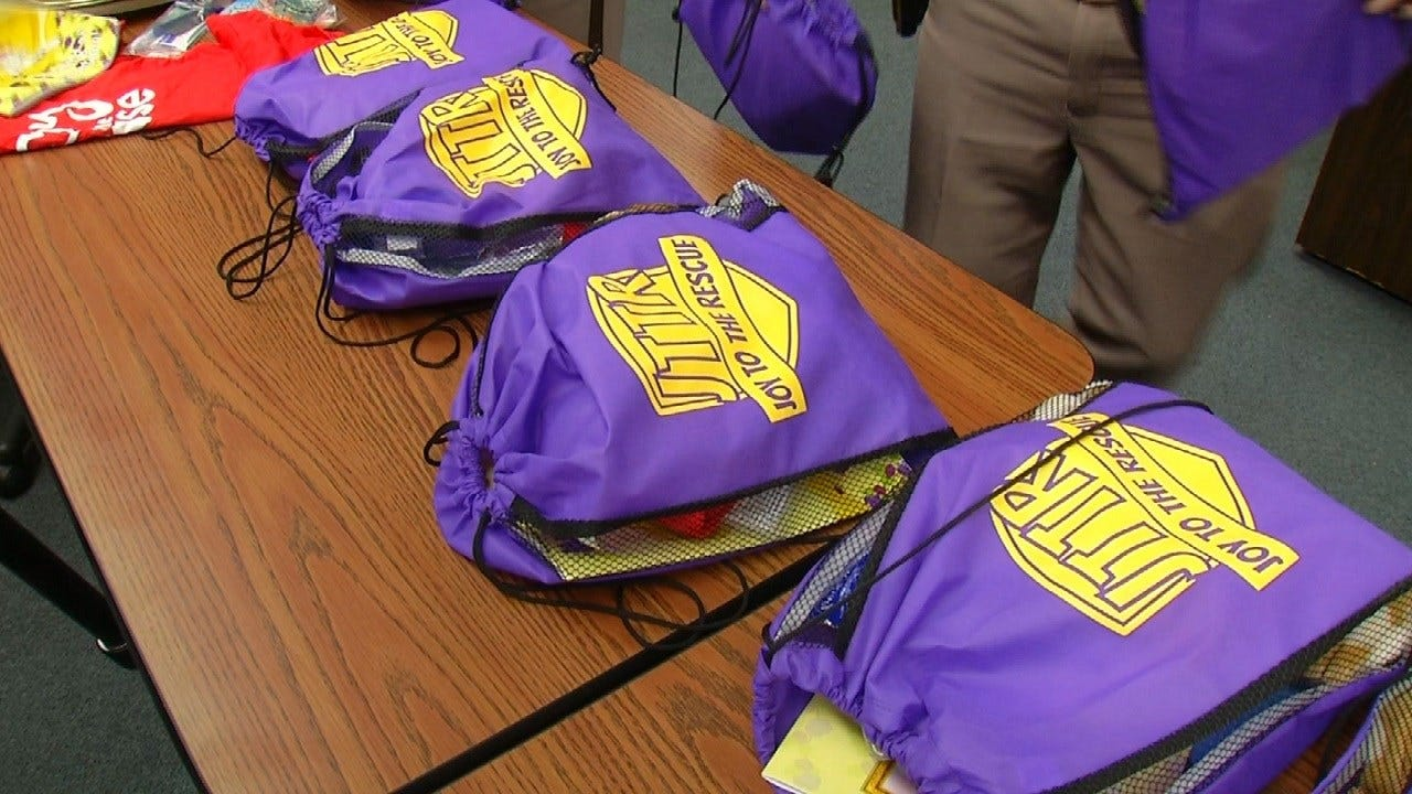 Joy In The Cause Donates 150 Stuffed Backpacks To Oklahoma Highway Patrol