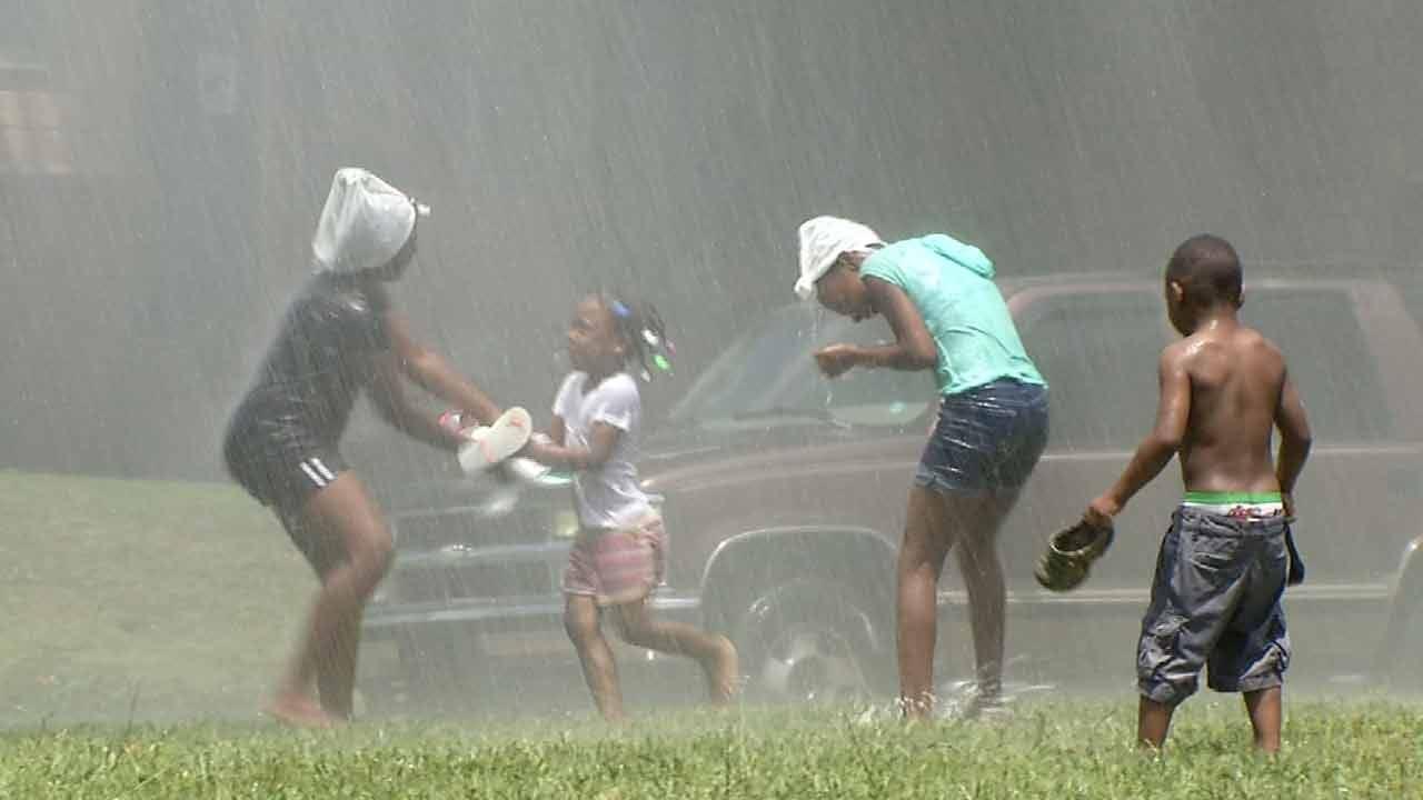 Kids Enjoy Tulsa Water Line Break
