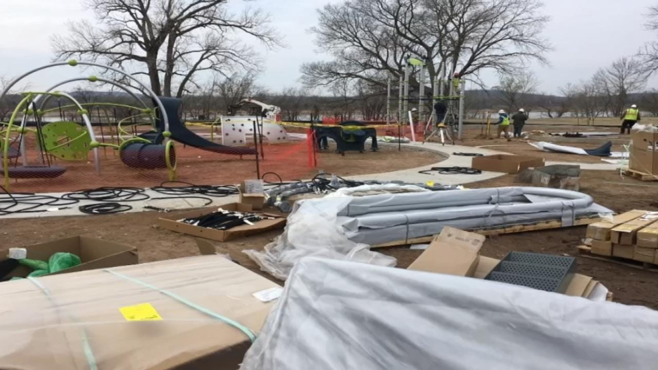 Workers Installing Playground Equipment At Sand Springs Park